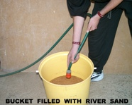 Bucket filled with river sand
