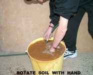 Rotate soil with hand