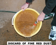 Discard of fine red dust